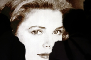 "Visitors view the exhibition ""The Grace Kelly Years"" at the Grimaldi Forum in Monaco. AFP PHOTO VALERY HACHE"